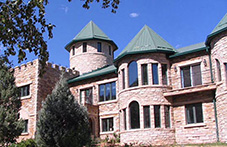 Side view of the Castle house, with Colorado buff stone facade. Loveland, Colorado.